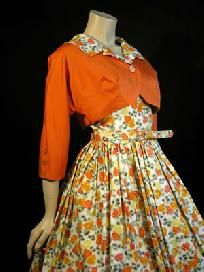 Vintage Fashion: this is so adorable. The orange cover up is a perfect addition to the white floral dress with orange and yellow flowers.
