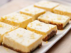 Limoncello Ricotta Cheesecake recipe from Ina Garten via Food Network Mais Lemon Cheesecake Bars, Cheesecake Squares, Cheesecake Recipes, Dessert Recipes, Limoncello Cheesecake Recipe, Party Recipes, Ina Garten Cheesecake Recipe, Brownies Cheesecake, Homemade Cheesecake