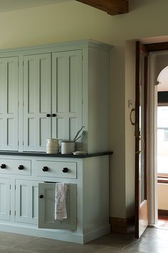Really like the look of this hutch. love the paned-panel doors and the top and bottom trim.                                                                                                                                                                                 More