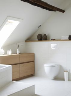 Toilet - in the attic. White, wood. Skylight.