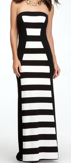 I love dresses that give off an optical illusion of having a gorgeous silhouette/body! [LOVE!]