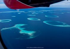 15 Useful Tips for Planning a Maldives Vacation | This World Traveled Maldives Vacation, All Inclusive Packages, Stay Overnight, Island Nations, Crystal Clear Water, Speed Boats, Plan Your Trip, Travel Around, Cool Places To Visit