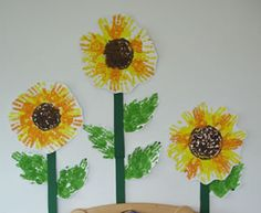Handprint sunflower :) I *LOVE* finger painting and sunflowers... this is a must!!
