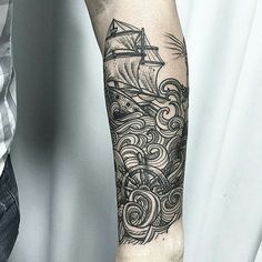 What about a wrap around the calf like this. With the lighthouse, ship and wave.