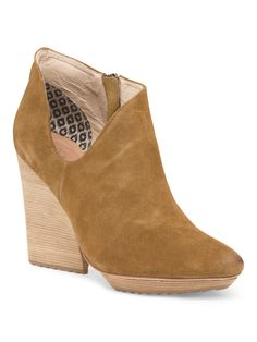 We love unexpected details. Stand out in this suede boot with a funky cut out.