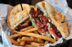 The Pickled Egg Pub's triple decker BLT on sourdough toast served with french fries. The restaurant is located at Pickled Egg, 2049 Northampton St., Wilson.
