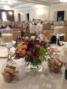 wine themed centerpieces - cork filled upside down wine glasses as candle bases | event center at blue