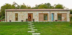 Vivienda Unifamiliar en Tomiño, Pontevedra (Spain) : Casas de estilo rústico de HUGA ARQUITECTOS