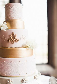 """Brides: Five-Tier Pink and Gold Lace Wedding Cake With a Piped Monogram. This elegant confection by Erica OBrien Cake Design embodies """"traditional with a twist""""— the lace pattern and piped monogram are classic cake embellishments while the blush-pink-and-gold color palette is fresh and unexpected."""