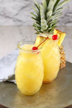 Pineapple Fuzzy Navel is a super simple and delicious party cocktail! I'm throwing some pineapple juice into my all time favorite mixed drink for a new twist on the classic. Summer Drinks, Fun Drinks, Alcoholic Drinks, Beach Drinks, Vodka Drinks, Frozen Drinks, Party Drinks, Amaretto Drinks, Pool Drinks