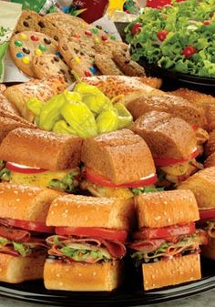Sub Party Platter with 20 2.5-Inch Sandwiches, Ten Bags of Chips, Two Salads, and Four Bowls of Toppings for $39