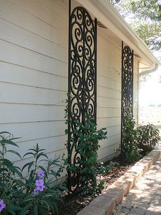 These Tableaux trellises are part of my new patio design. They look like they are made of iron but are actually custom made from a water resistant composite wood material - faux iron.