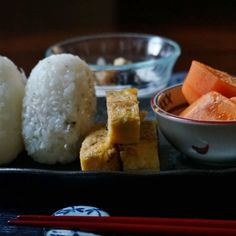 bkf = dried tiny sardine rice ball, rolled egg with Shio-kombu kelp, miso soup, persimmon, yogurt with walnuts and blueberry jam