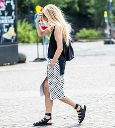 A standard slit skirt is an excellent choice, but we also love how a wrap skirt creates a similar effect. @WhoWhatWear
