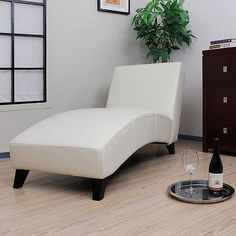This stylish leather chaise adds a comfortable seating option to your living room, bedroom or den. Featuring a modern design and strong wood construction, the cream lounge chair is coated with polyurethane to help to guard against spills.