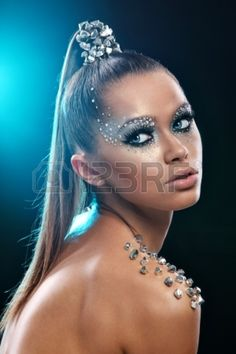 17980748-portrait-of-woman-with-artistic-make-up-and-rhinestones-over-background.jpg (900×1350)
