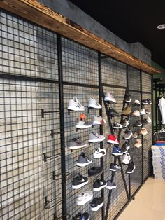 This design of the shoes is very functional thing because it is easy to put them on the black wall thing. Shoe Store Design, Clothing Store Design, Retail Store Design, Retail Display Shelves, Shoe Display, Showroom Interior Design, Boutique Interior, Surf House, Fashion Retail Interior
