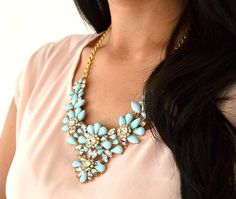 Jeweled multi colored stones set in a dark gunmetal setting. Each stone is enlayed to form a flower motif around light blue stones and clear rhinestones. #crystal #necklace #statement #bauble #jewelry #nail #polish #pink #gold #stone #pendant #neckcandy #neckparty#earrings #jewels #flowers #rhinestone #crystal #studs #jewelry #fashion #style
