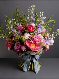 Wild At Heart - English Country Bouquet - A selection of our favourite flowers which make a regular appearance in beautiful English Country Gardens during Summer. This fabulous bouquet is made up of mixed peonies, foxgloves, delphinium and roses.