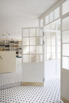 // norm architects, hexagon floor tile, white doors, natural wood, store, interiors, entry, white walls, natural light