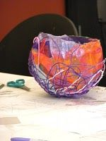 yarn and tissue paper sculpture on a balloon form - Chihuly inspired