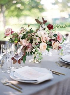 blush and white centerpiece with burgundy additions