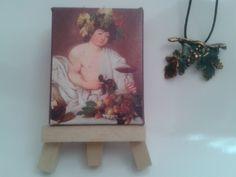 """Pieza realizada en Bronce Patinado, inspirada en el cuadro """"Baco"""" del pintor italiano Caravaggio, conservada en la Galería de los Ufizzi de Florencia (Italia).  Se regala un cuadro en miniatura de Los Girasoles con su caballete."""