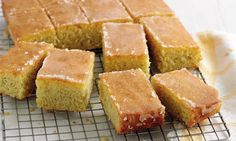 Treat yourself to Mary Berry's Lemon Drizzle Traybake Mary Berry's lemon drizzle traybake is an all-time favourite as it's so moist, really easy to make and full of zesty, zingy flavours Great British Bake Off, Tray Bake Recipes, Dessert Recipes, Baking Recipes Uk, Lemon Drizzle Traybake, British Baking, Banana Split, Food Cakes, Tray Bakes
