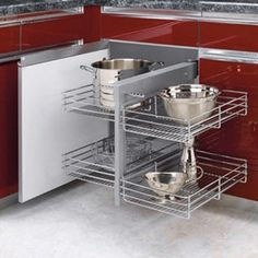 Blind corner wire pullout shelves - instead of those awful lazy susan cabinets!  Must have this!!
