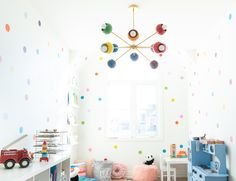 Sputnik style chandelier with rainbow colored shades and mid century modern design. Great for kids bedrooms and more. Baby Boy Nursery Decor, Nursery Design, Baby Boy Nurseries, Mid Century Modern Chandelier, Chandelier Bedroom, Rainbow Decorations, Mid Century Modern Design, Colorful Interiors, Modern Interior