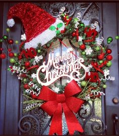 Adorable Christmas wreath with Santa Hat & big red bow.