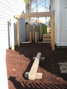 Modern private playground in a small space using port orford cedar. Includes: arbor swing-set, parallel bars, monkey bars and balance beam. All pieces built and installed by Le Reve Garden Design. Space design: Trent Lloyd Design.