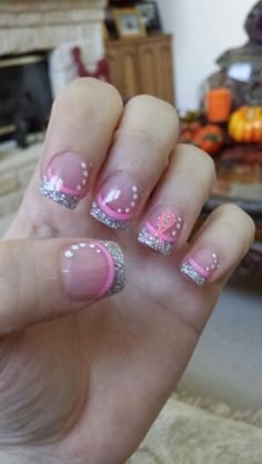 Love my breast cancer nails I had done today!