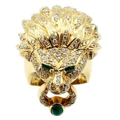 Emerald Diamond Gold Lion Head Ring | From a unique collection of vintage fashion rings at https://www.1stdibs.com/jewelry/rings/fashion-rings/