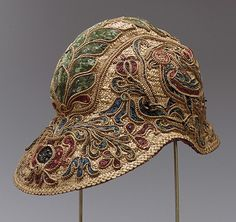 Helmet    Date:      16th century  Culture:      Spanish  Medium:      straw, metal, silk  Dimensions:      H.: 6 ½ in. ( 16.5 cm). L.: 11 ½ in. (29.2 cm). W. 7 1/2 in. (19.1 cm)  Credit Line:      Rogers Fund, 1932  Accession Number:      32.132    This artwork is not on display