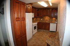 Cherry stain, white appliances, marble backsplash