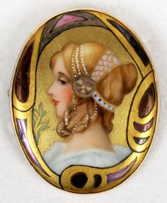 Art Nouveau Hand Painted Oval 10K Yellow Gold Brooch. This multi color hand painted portrait of a women, is set in a 10k yellow gold bezel, measuring approximately 2.50 x 1.75 inches in diameter.