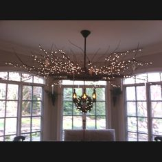 Light fixture made of tree branches and three wine bottles! Made by my dad