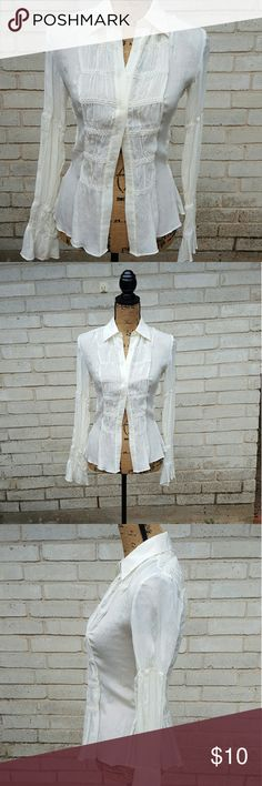 "Express Semi Sheer Ivory Steampunk Button Down Express brand semi sheer ivory button down blouse. Beautiful silk like fabric with bell sleeves and shirred elastic back. Detailing all over. Tagged size 1/2  , Fits a Small. Runs true to size.  Excellent condition.  Measurements : Length 23"" 15"" across front laying flat buttoned  #ravenkittystyle #express #Buttondown #steampunk #sheer #semisheer #ivory #cream #small #xs Express Tops Button Down Shirts"
