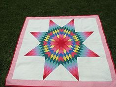 Vintage Lone Star Quilt. Pretty color placement.
