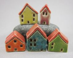 elukka shop on etsy, aren't they sweet?  Little slab constructed pottery houses