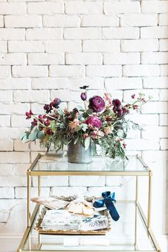 Gold side table with bright florals
