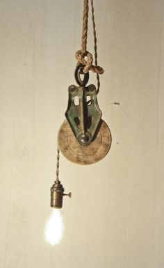 This green pulley light is filled with a barn spirit ! It's soft light and adjustable height would fit perfectly in any room's corner.ON/OFF knob on socket7 foot of rope7 foot of beige cloth-covered wire40 watts Edison style bulb included