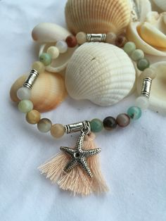 Ocean Agate Boho Beaded Stretch Bracelet (6mm) with Sterling Silver Beads Tassels and Shell Charm by DreamCuff