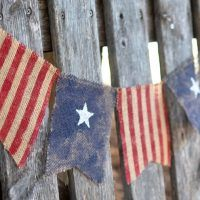 Check out our latest collection of patriotic decor featuring 16 Festive Handmade of July Banner Designs For The Perfect Backdrop. Patriotic Wreath, Patriotic Decorations, 4th Of July Wreath, Wall Decorations, Burlap Flower Wreaths, American Flag Wreath, Diy Banner, Bowl Fillers, Recycled Art