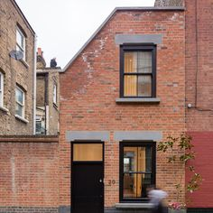 Kirkwood McCarthy has renovated a derelict workshop in the east of the city to create a brick house that is squeezed onto the end of a narrow mews yard