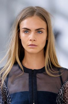 straight #hair with a mid parting on Cara Delevingne