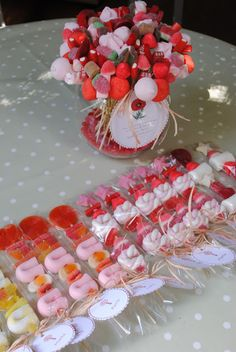 the candy on sticks could match wedding colors or theme