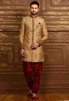 Step out in style wearing this Golden wedding wear Sherwani Banarasi Silk fabricated Sherwani with Embroidery work from our exclusive collection of Party wear Designer Men's wear . Indian Groom Wear, Indian Wedding Wear, Indian Bridal Fashion, Pakistani Wedding Dresses, Indian Wear, Indian Weddings, Sherwani Groom, Mens Sherwani, Wedding Sherwani