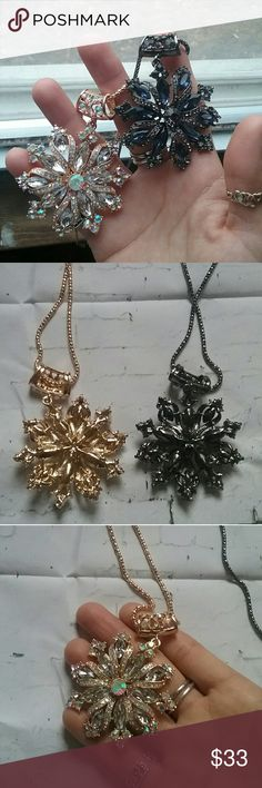 Flower charm necklaces NWOT Goldtone & dark silvertone flower charm necklaces New without tags. Really cute and sparkly! The chain Is about 27 inches long and The flower is about 3 inches long. The chain is light but the charm is heavy. The chain is stamped BJ. Please take a look at my closet to bundle and save, Offers welcome!🤗 Jewelry Necklaces